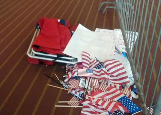 flags on floor at Clinton event