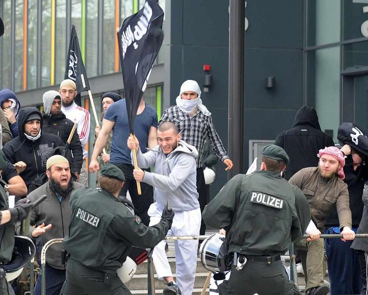Germany - Muslims throw down with the police. (Photo: Pinterest.)