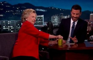 Hillary opens a pre-opened jar of pickles to prove she's healthy.