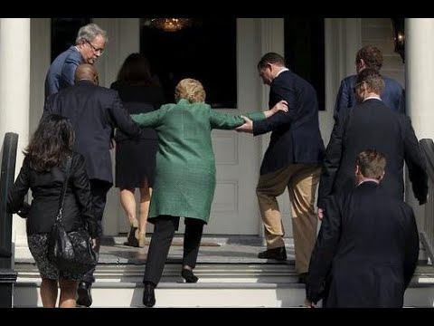 Clinton struggles up a few steps. (Photo: Youtube)