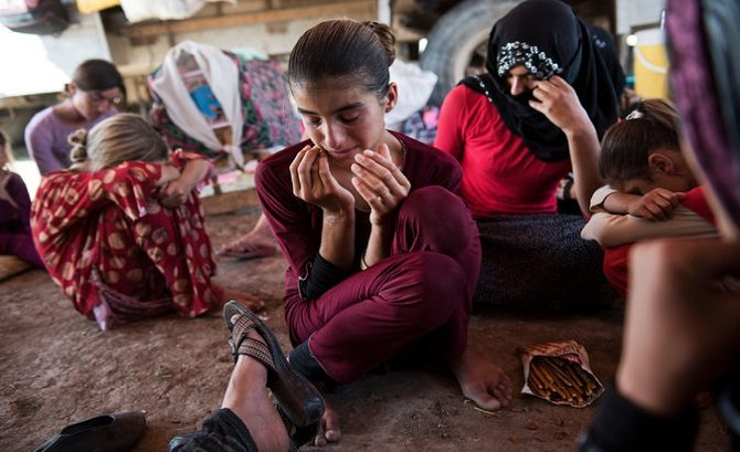 Islam in action. Yazidi women and girls await their turn on the Muslim auction block (Free use - Bing).