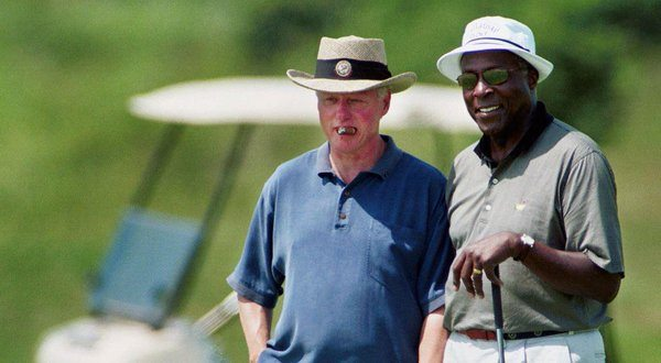 A cigar chomping Bill Clinton with his golf buddy Vernon Jordan. (Twitter)