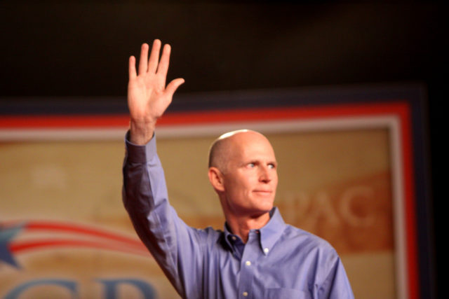 Media demands Gov. Rick Scott break Florida law to help Hillary