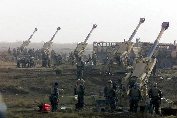 India Battery, 3rd Battalion, 5th Marines, 1st Marine Division, prepare to fire their M198 155mm Howitzers against possible enemy targets during the Iraq War. (Wiki)