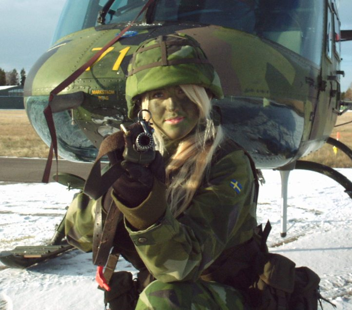 Sweden - Except for the stunning blonde locks, Swedish soldier-ette attempts to look tough when cammoed-up. (Facebook)