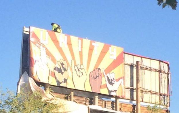 Artist Paints an Anti-Trump billboard along Phoenix Roadway
