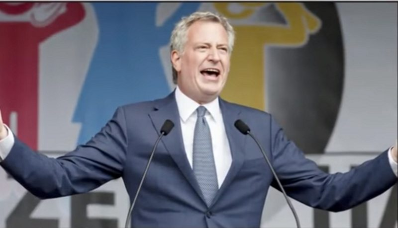 Elderly Woman Angrily Confronts de Blasio for Jetting to Germany