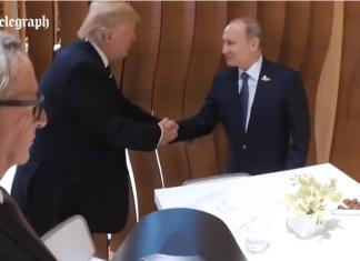 Trump Putin shake hands
