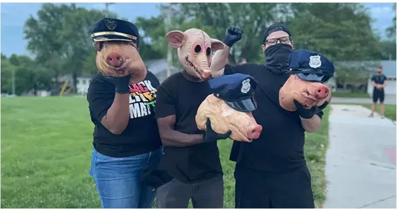 three severed pig heads