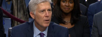 Mystery solved: Who the woman is sitting behind Gorsuch
