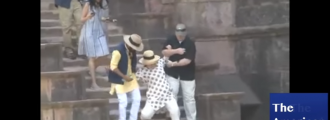 Video: Watch Hillary Clinton slip down stairs in India despite two men holding her up